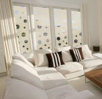 Sandstone Portholes decorating living room windows