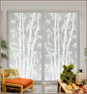 Tall sliding glass doors decorated with Big Bamboo privacy window film.