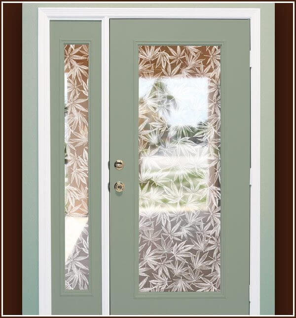 Door and sidelight decorated with Pot Leaf etched glass window film design.