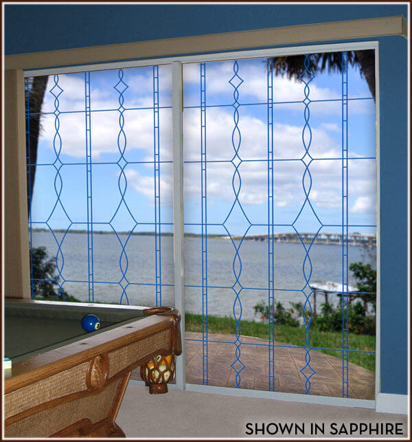 Sliding glass doors with river view decorated with Allure design in sapphire.