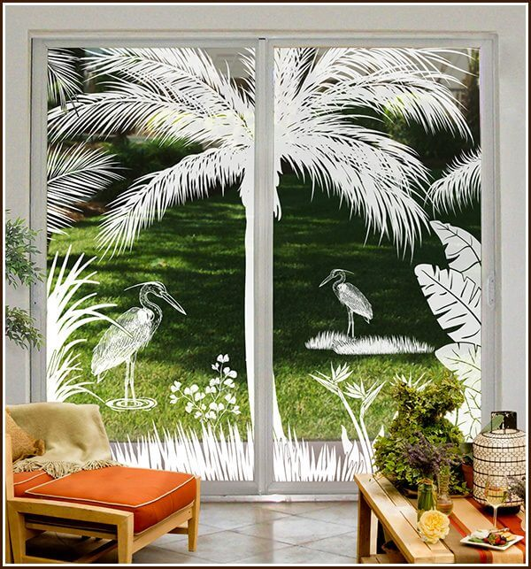 Sliding glass doors that are 8 ft tall decorated with Heron Hideaway decorative window film.